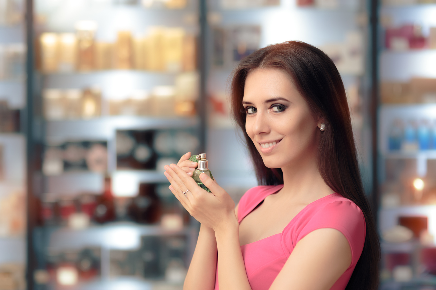 Smiling Woman Holding Retro Perfume Bottle